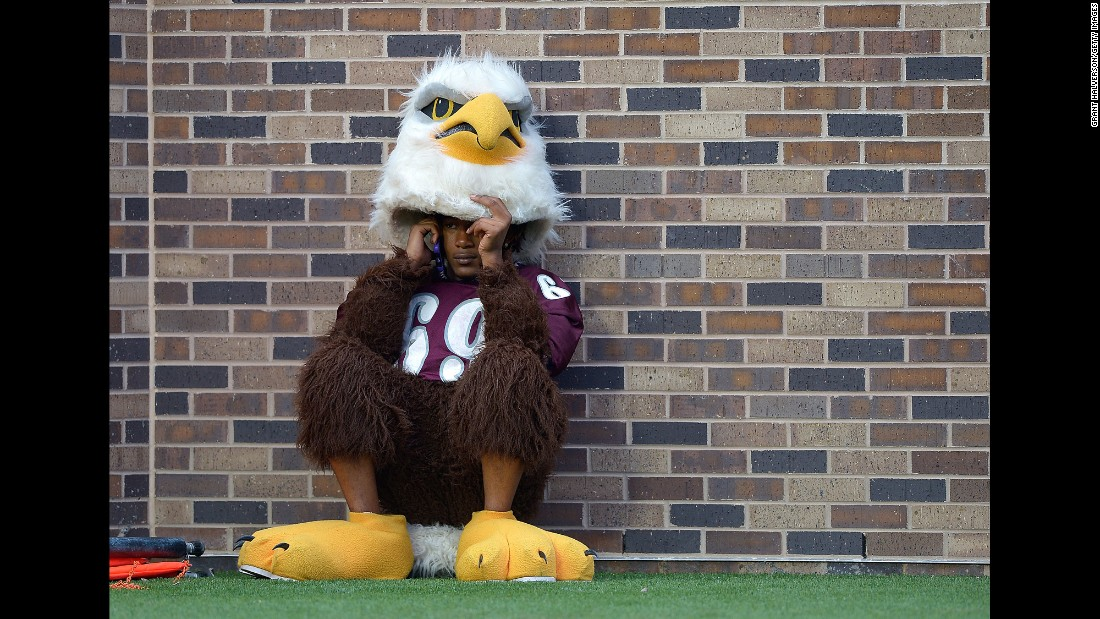 The mascot of the North Carolina Central Eagles takes a phone call during a football game against Duke in Durham, North Carolina, on Saturday, September 3.