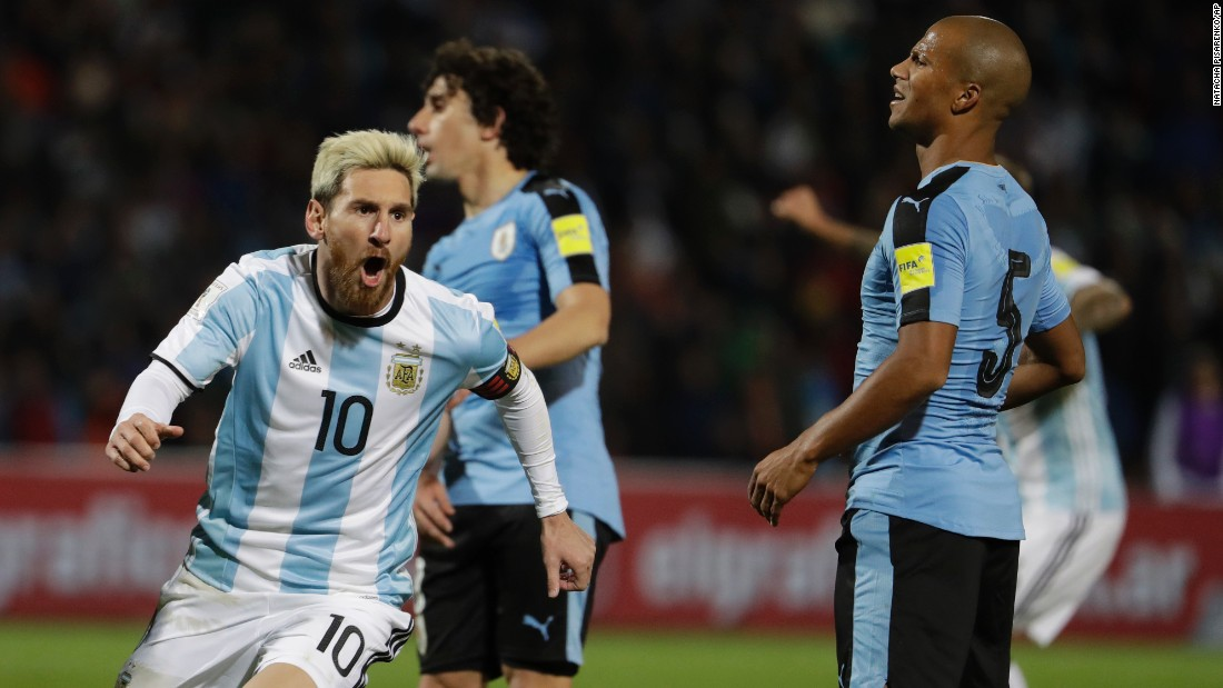 Argentine soccer star Lionel Messi, left, celebrates scoring against Uruguay during a World Cup 2018 qualifying match in Mendoza, Argentina, on Thursday, September 1. Argentina won 1-0.