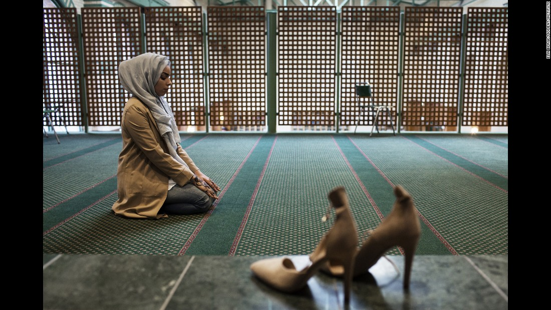 Moufid prays in a Stockholm mosque.