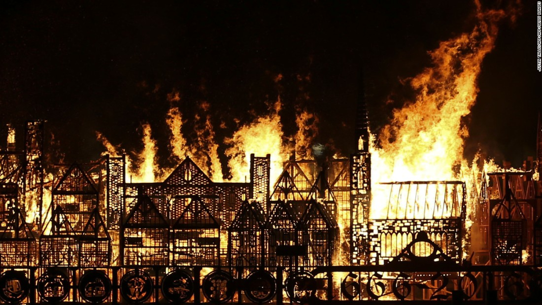 Crowds gathered in London on Sunday night to watch flames devour a replica of the city's 17th-century skyline to mark the 350th anniversary of the Great Fire of London.