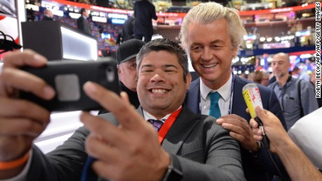 Dutch politician Geert Wilders, right, poses  with delegates at the  Republican convention in Cleveland, Ohio, in August.