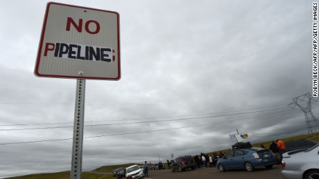 "A modified highway sign reads ""No Pipeline"" near the site of a protest against the Dakota Access Pipeline."