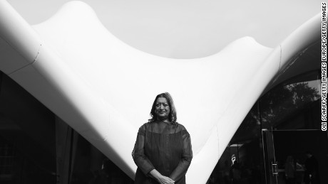 The late architect Zaha Hadid poses in front of the redeveloped Serpentine Sackler Gallery in Hyde Park in London