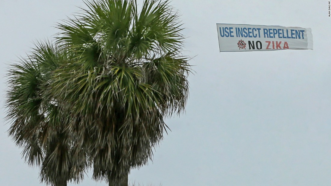 A banner is flown over the South Pointe Park area, Tuesday, September 6, in Miami Beach, Florida.