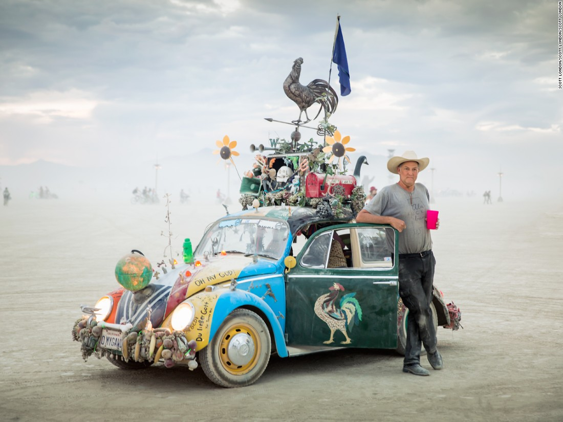 """This whimsically-decorated Beetle was created by artist and filmmaker Harrod Blank (pictured) and is generally considered the first art car at Burning Man. While it's no longer designated a 'mutant vehicle,' it has a special permit to be on the playa thanks to its historic significance at the event."""