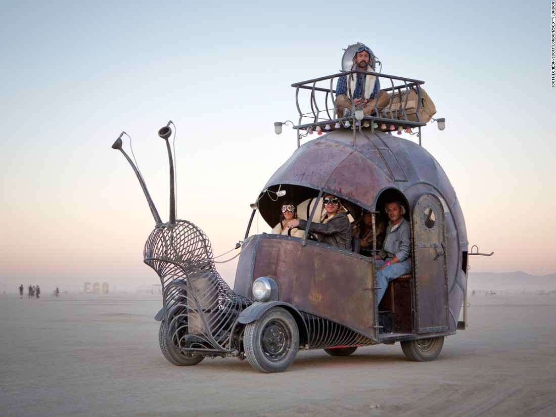 """Artists Jon Sarriugarte and Kyrsten Mate built this snail-shaped art car on top of a 1966 VW Beetle floor pan with scales made of galvanized scrap metal. It can hold up to 19 people, most of them inside but a few on top of the shell on a special viewing platform."""