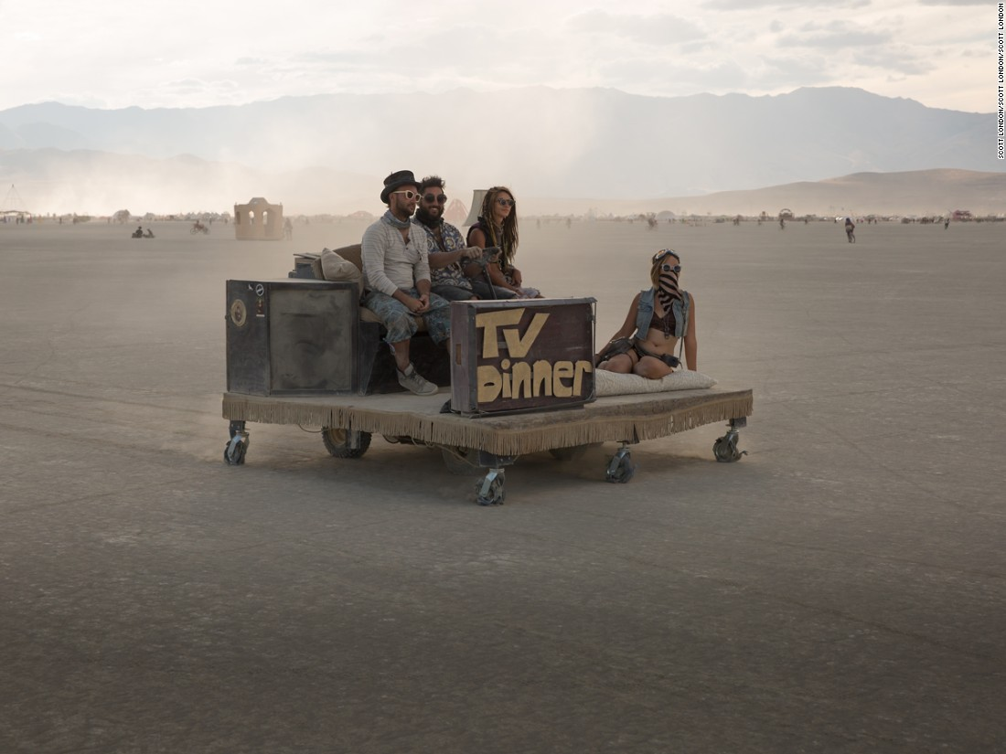 """Some mutant vehicles are little more than modified golf carts, like this concept car consisting of a platform and a couch ferrying a few friends across the playa at Burning Man 2016."""