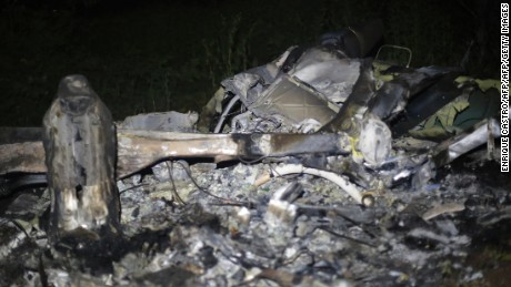 Picture of the wreckage of a helicopter that was involved in a police operation and was allegedly shot down by drug traffickers, taken late on September 6, 2016 in La Huacana, Michoacan State, Mexico. A police helicopter crashed Tuesday during an operation to capture suspected gang leaders in western Mexico, and authorities were investigating whether gunmen shot it down, killing three officers and the pilot. / AFP / ENRIQUE CASTRO        (Photo credit should read ENRIQUE CASTRO/AFP/Getty Images)