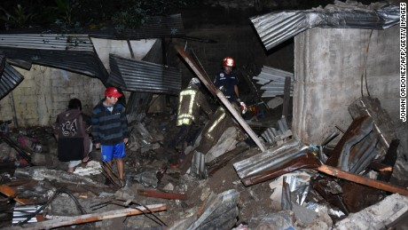 Rescuers respond after a landslide hit the village of Santa Isabel south of Guatemala City.