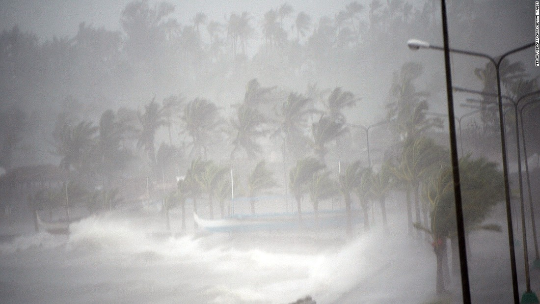 Typhoon Hagupit's violent wind and rain pound the seawall, before passing through the city of Legazpi in 2014.