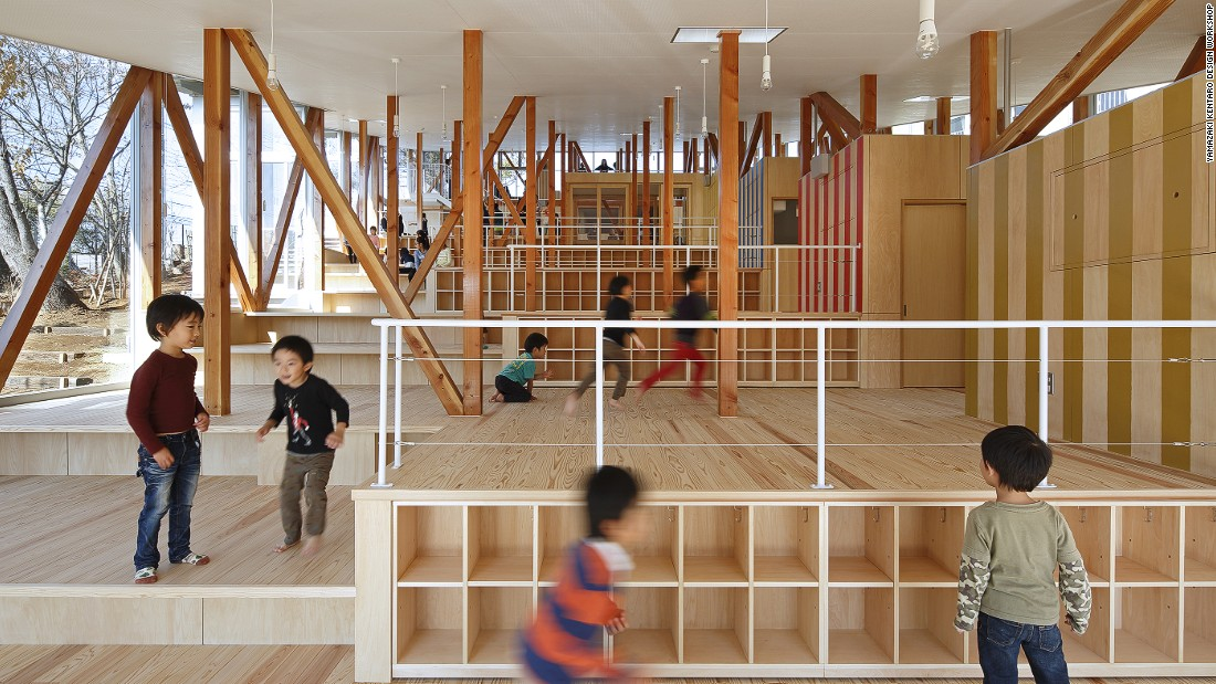 This nursery school was designed to accommodate 60 students in a large house environment, and is similar in style to many of the houses in the surrounding farming communities. The school includes features that embrace its natural setting, like a rainwater pond for the students to play in.
