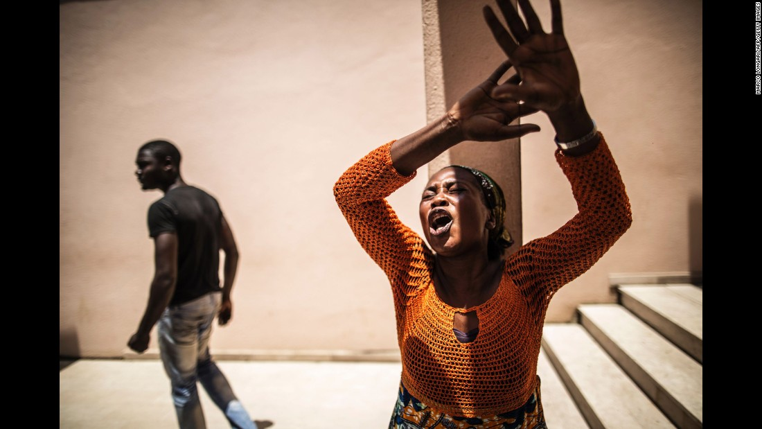"A woman reacts outside the Libreville Magistrate Court in Libreville, Gabon, on Tuesday, September 6. <a href=""http://www.cnn.com/2016/09/01/africa/gabon-election-protests/"" target=""_blank"">Violence erupted in the country's capital</a> as protesters clashed with police after the announcement that incumbent President Al Bongo had won the presidential election."