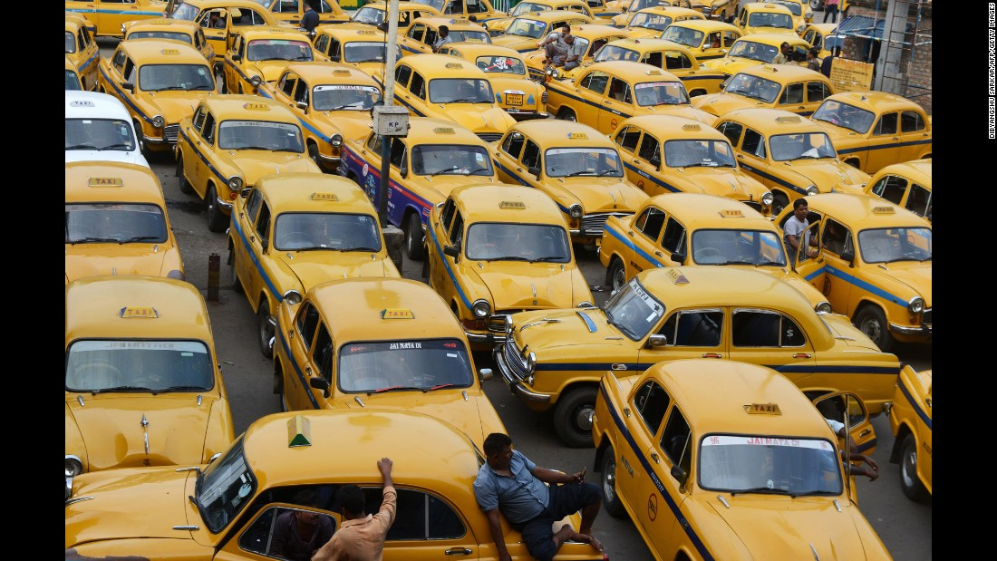 "Taxi drivers wait for passengers outside a railway station in Kolkata, India, during a strike on Friday, September 2. <a href=""http://www.aljazeera.com/news/2016/09/millions-indian-workers-strike-wages-160902131706206.html"" target=""_blank"">According to Al Jazeera</a>, millions of public sector workers went on a daylong nationwide strike to protest Prime Minister Narendra Modi's economic plans."