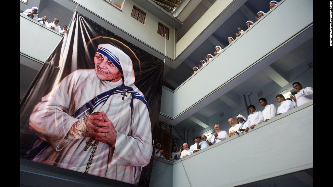 "Roman Catholic nuns of the Missionaries of Charity look on after a service for the late Mother Teresa in Kolkata, India, on Monday, September 5. Mother Teresa, who devoted her life to helping the poor and ill in India, was <a href=""http://www.cnn.com/2016/09/04/europe/mother-teresa-canonization/"" target=""_blank"">declared a saint by Pope Francis</a> in a canonization mass at the Vatican on Sunday, September 4."