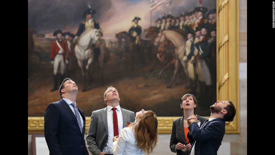 People look at the ceiling of the newly restored rotunda inside the US Capitol in Washington on Tuesday, September 6.