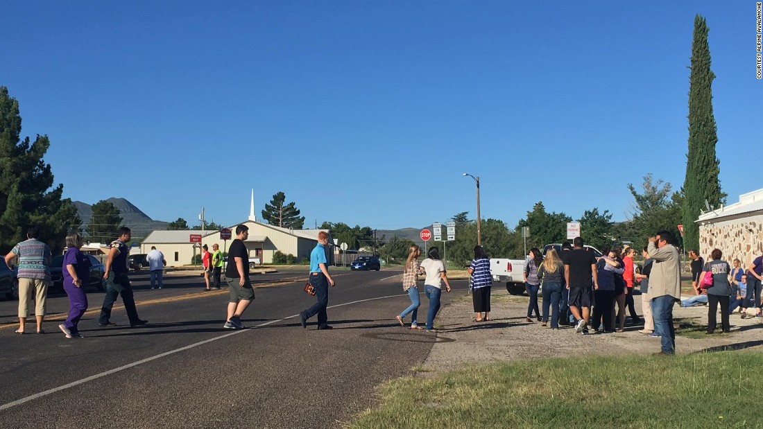 "People cross a street after <a href=""http://www.cnn.com/2016/09/08/us/texas-high-school-shooting/index.html"" target=""_blank"">a shooting at Alpine High School</a> in Alpine, Texas, on Thursday, September 8. One student shot and wounded another before fatally shooting herself Thursday morning at the western Texas high school, a sheriff said."