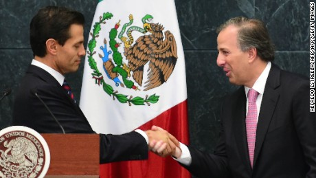 Mexican President Enrique Pena Nieto (L) shakes hands with the new Secretary of Finance, Jose Antonio Meade, after swearing him in during a ceremony at Los Pinos presidential residence in Mexico City on September 7, 2016. Mexico's finance minister Luis Videgaray stepped down on Wednesday, a surprise move that follows his reported key role in Donald Trump's controversial meeting with President Enrique Pena Nieto. Pena Nieto said he had accepted Videgaray's resignation and replaced him with Social Development Minister Jose Antonio Meade, a former foreign minister who held the finance job between 2011-2012.  / AFP / ALFREDO ESTRELLA        (Photo credit should read ALFREDO ESTRELLA/AFP/Getty Images)
