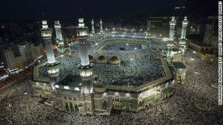 Muslim pilgrims attend the evening prayers inside the Grand Mosque in Mecca