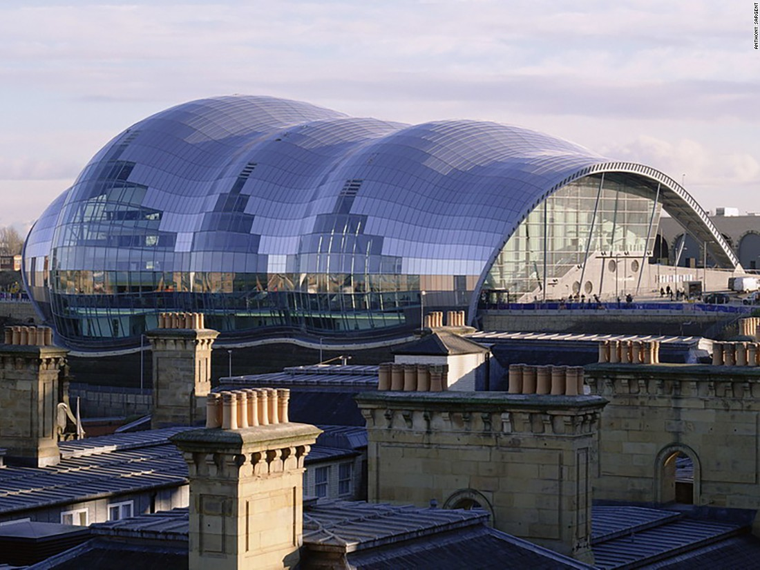 Designed by Foster + Partners, the Sage Gateshead contains three freestanding concerts halls. Joining them is a glass and steel shell-like canopy that is said to resemble the shape of a trumpeter's knuckles. It cost £46m ($61m) to build and opened in 2004 as part of the Gateshead Quays redevelopment that also saw the arrival of the BALTIC Centre for Contemporary Art and the Gateshead Millennium Bridge. At its peak, the Sage is twice the height of Anthony Gormley's Angel of the North sculpture. It was also constructed using a special type of concrete that contains extra air bubbles to help control its acoustics and provide sound-proofing.