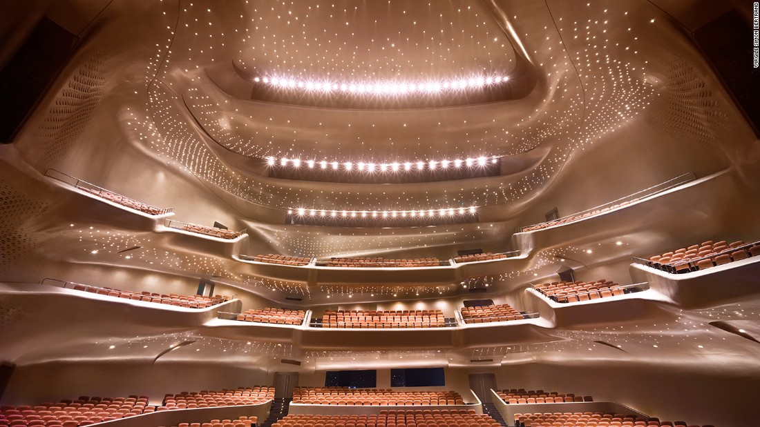 Built in 2010, China's riverside Guangzhou Opera House has the signature touch of the late Zaha Hadid. Its contoured profile was inspired by river valleys and the way they constantly change shape through the process of erosion. Constructed from 12,000 tons of steel, the Opera House includes an 1,800-seat and a 400-seat theater.