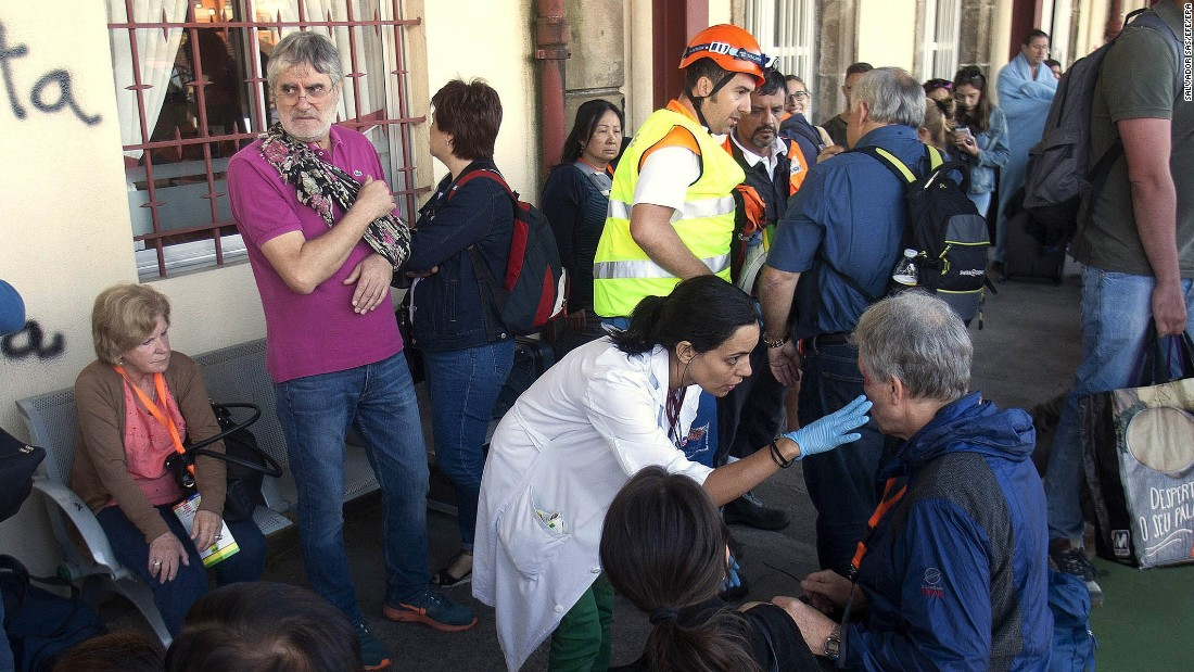 Spanish emergency service workers tend to injured passengers near O Porrino.