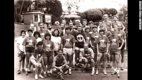 Peter Remsen's Hash club in Tokyo in the 1980s. He is wearing a jacket and squatting in front.