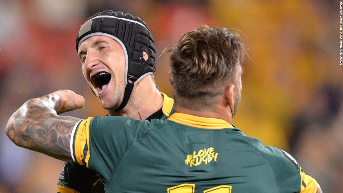 Johan Goosen of the Springboks celebrates with team mate Francois Hougaard after scoring a try during the Rugby Championship match between the Australian Wallabies and the South Africa Springboks at Suncorp Stadium on September 10, 2016 in Brisbane, Australia.