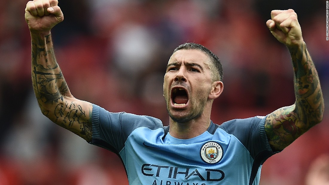 Manchester City's Serbian defender Aleksandar Kolarov celebrates on the pitch after the English Premier League football match between Manchester United and Manchester City at Old Trafford in Manchester, north west England, on September 10, 2016.