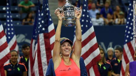 Angelique Kerber of Germany holds up her winning trophy after defeating Karolina Pliskova of Czech Republic in their 2016 US Open Womens Singles final match at the USTA Billie Jean King National Tennis Center in New York on September 10, 2016. New world number one Angelique Kerber won the US Open title on Saturday with a battling 6-3, 4-6, 6-4 victory over Karolina Pliskova of the Czech Republic. / AFP / Timothy A. CLARY        (Photo credit should read TIMOTHY A. CLARY/AFP/Getty Images)