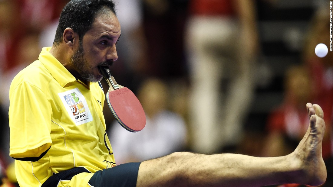 Ibrahim Hamato -- pictured at the 2016 World Team Table Tennis Championships -- came up with an ingenious way to continue playing table tennis after losing both his arms in an accident as a child.