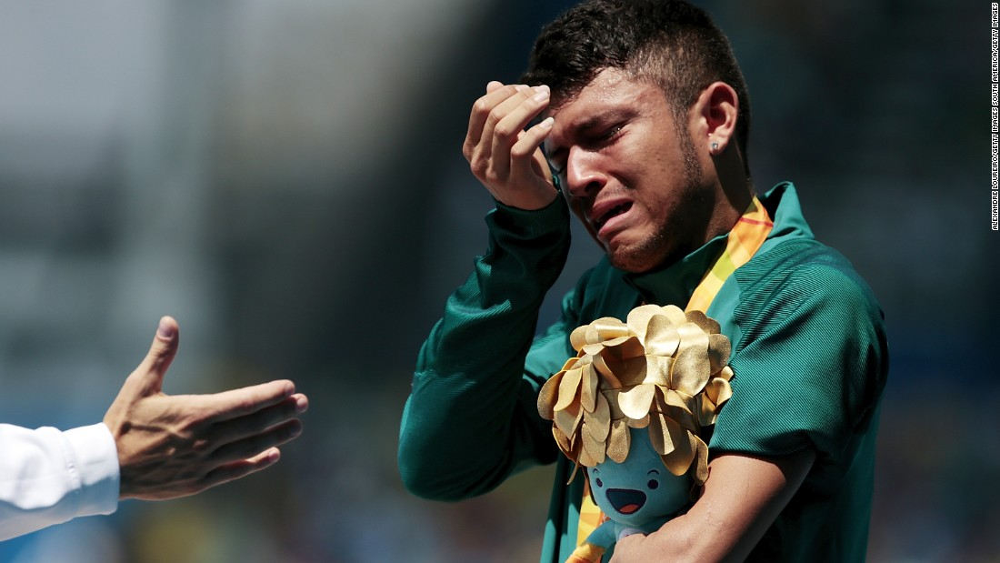 Ferreira dos Santos of Brazil couldn't contain his emotion during the national anthem after receiving his medal on the podium.