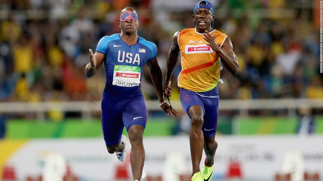 David Brown on his way to winning T11 gold with his guide Jerome Avery and becoming the first full blind man in history to run sub-11 seconds. Brown is also a talented musician and play drums, piano and tenor saxophone.