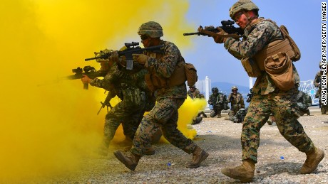 South Korean and US marines move to a position during a re-enactment of the Incheon landing to mark the 66th anniversary of the start of Operation Chromite, the battle that turned the tide in the Korean War, in the western port city of Incheon on September 9, 2016.