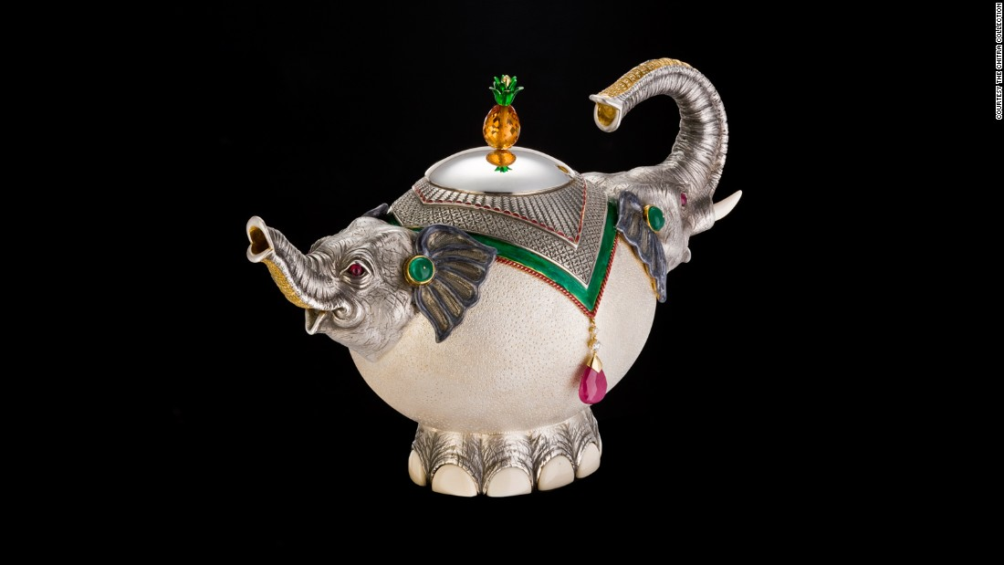 This teapot was specially commissioned by the Chitra Foundation. It incorporates emeralds, yellow diamonds, ruby, topaz and ivory.