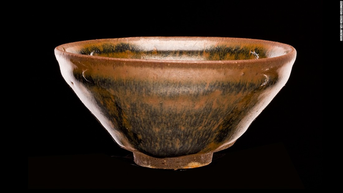 "This tea bowl was produced just as the kiln started being used across China. It's called a ""hare's fur"" tea bowl because the glaze is said to resemble it."