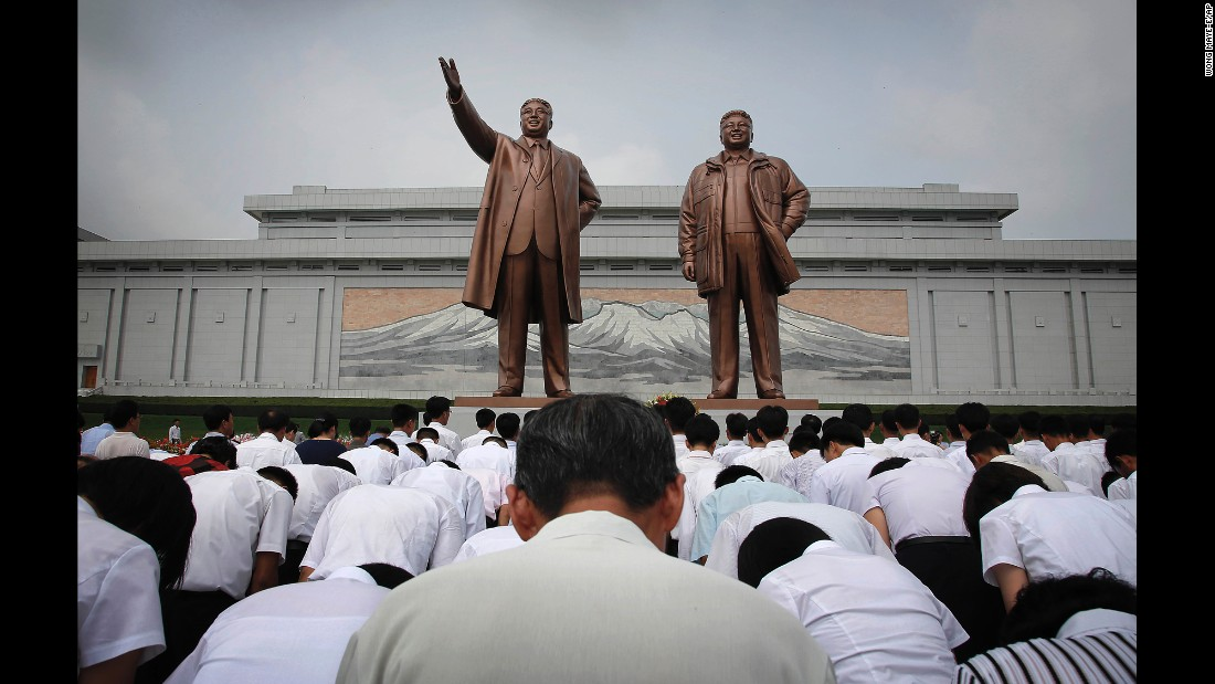 North Koreans bow in front of statues depicting the late leaders Kim Il Sung and Kim Jong Il at Munsu Hill during celebrations for the 62nd anniversary of the Korean War armistice.