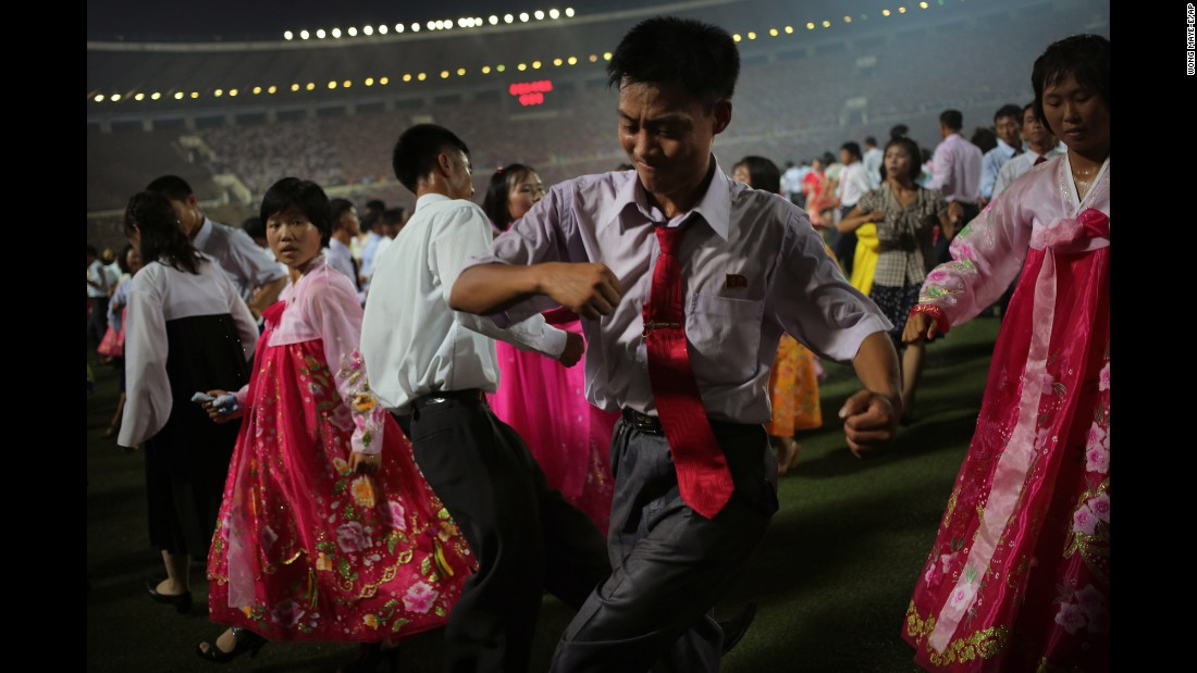 Kids participate in a mass dance party at Kim Il Sung Stadium during celebrations marking the 60th anniversary of the Korean War armistice.
