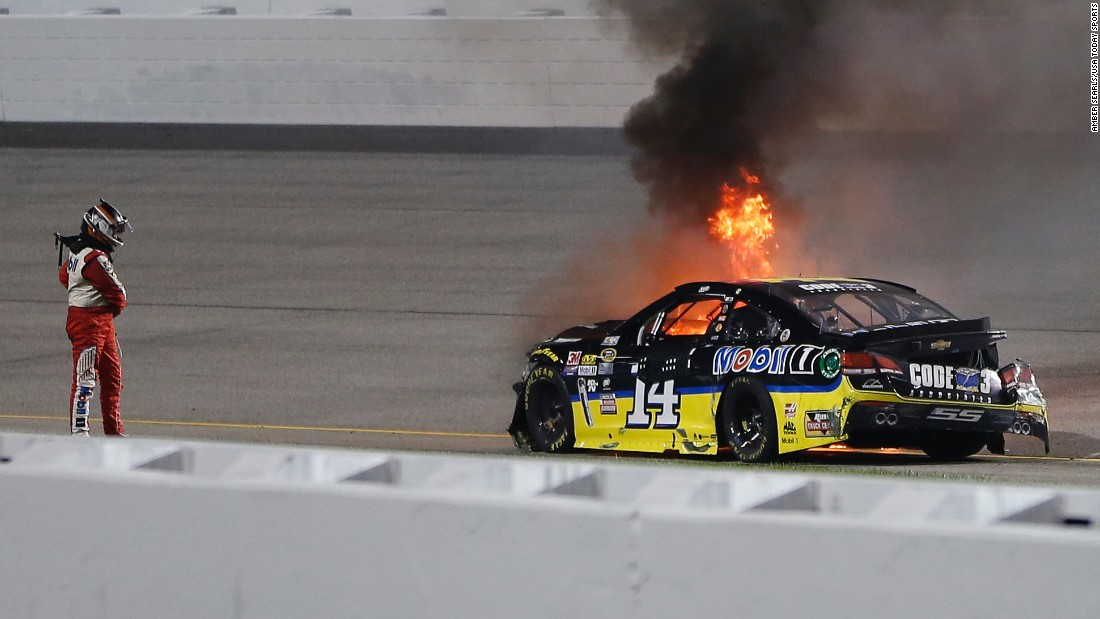 Tony Stewart watches as his car catches fire after crashing in the NASCAR Federated Auto Parts 400 in Richmond, Virginia, on Saturday, September 10.