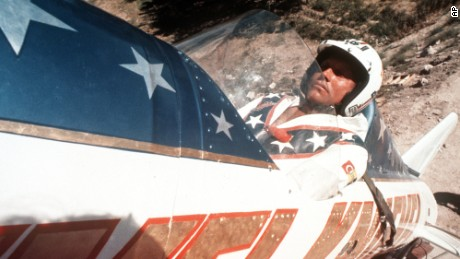 FILE - In this Sept. 8, 1974, file photo, Evel Knievel sits in the steam powered rocket motorcycle that will hopefully take him across Snake River Canyon in Twin Falls, Idaho. Fueled by the memory of the late daredevil Knievel, Hollywood stuntman Eddie Braun plans to strap into a steam-powered rocket cycle on Sept. 17, 2016, for his most death-defying role yet. (AP Photo, File)