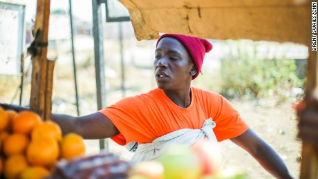A vender sells fruit in Harare's Epworth neighborhood,the scene of several protests in recent months.