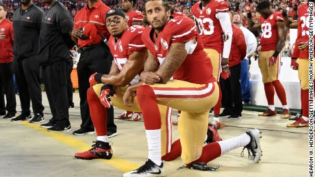 San Franciso 49ers Colin Kaepernick, right, and Eric Reid kneel in protest during the national anthem.