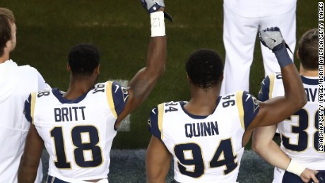 LA Rams' Kenny Britt and Robert Quinn raise their fists in protest prior to their game against the San Francisco 49ers.