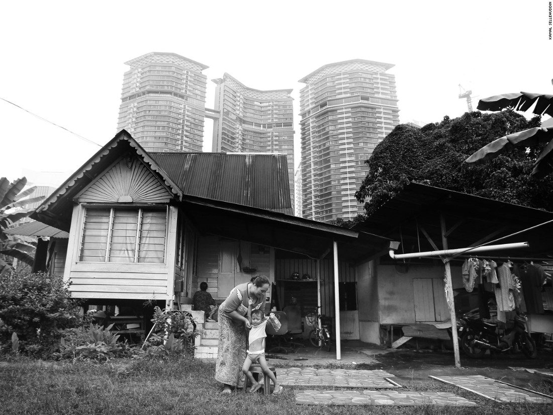 """""""This village is facing a fierce clash of cultures between the modern and traditional. We are beginning to see high-rise apartments creep into the area as well. Perhaps in a just a few short years, Kampung Baru as we know it will have changed entirely,"""" says Sellehuddin."""