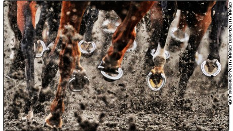 SUNBURY, ENGLAND - JULY 02: (This image was processed using digital filters) Horses hooves at Kempton Park racecourse on July 02, 2014 in Sunbury, England. (Photo by Alan Crowhurst/Getty Images)
