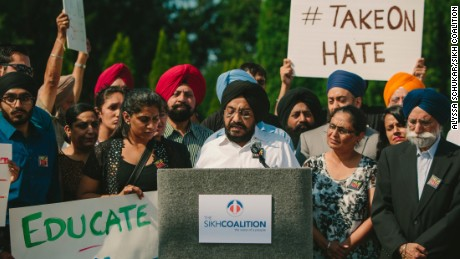 """The Sikh Coalition holds a press conference and rally in Darien, Illinois where Mr. Inderjit Singh Mukker was the victim of a hate crime.   Alyssa Schukar Photography released to the Sikh Coalition  alyssa@alyssaschukar.com 402-770-3968\  September 8, 2015: Inderjit Singh Mukker is viciously assaulted in the Chicago suburb of Darien by a teenager who yells: """"Terrorist, go back to your country"""" and """"Bin Laden!"""" Mukker is left unconscious and has to be hospitalized after the beating."""