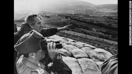 Shimon Peres, then defense minister, points over the northern Israel border toward Lebanon in 1976.