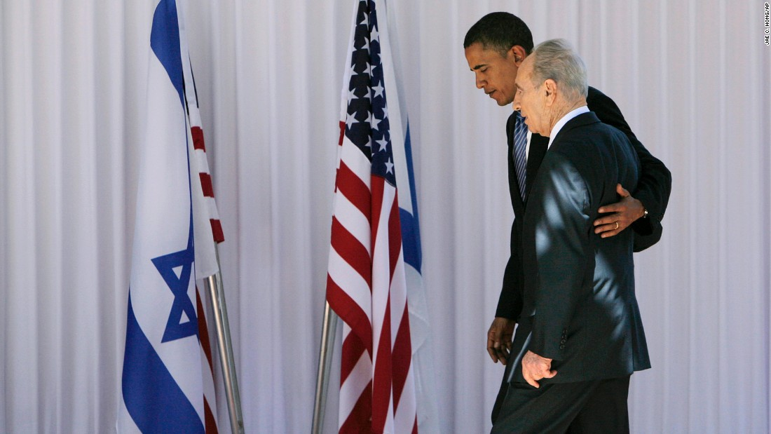 Democratic presidential candidate Barack Obama, then a US Senator from Illinois, walks with Israeli President Shimon Peres in Jerusalem on July 23, 2008.