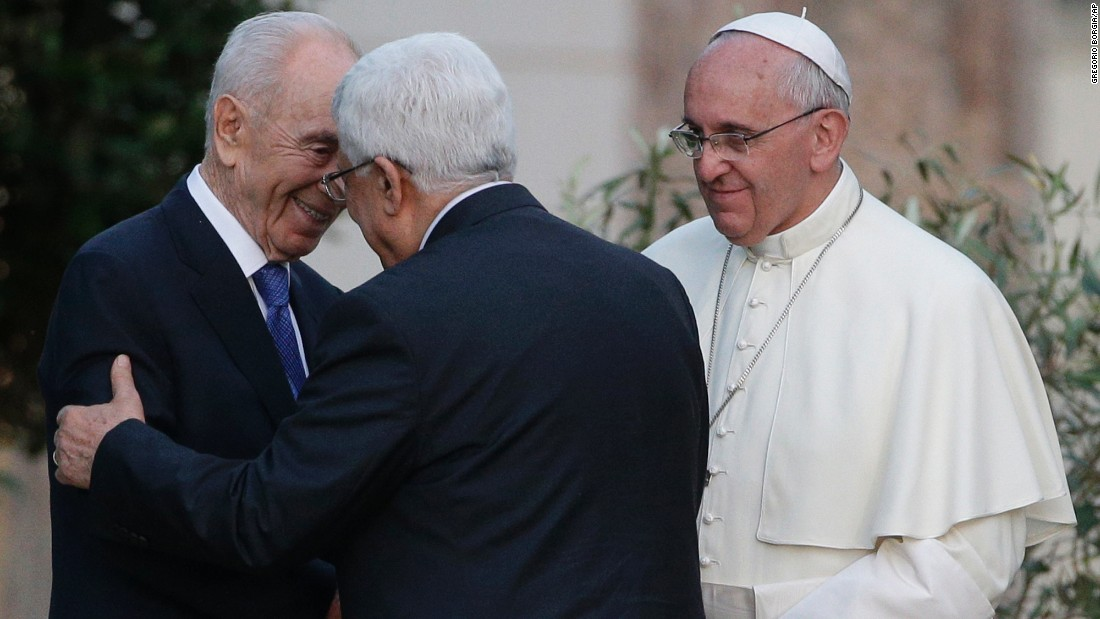 Pope Francis looks on as Israeli President Shimon Peres, left, and Palestinian President Mahmoud Abbas greet each other during an evening of peace prayers at the Vatican on June 8, 2014.