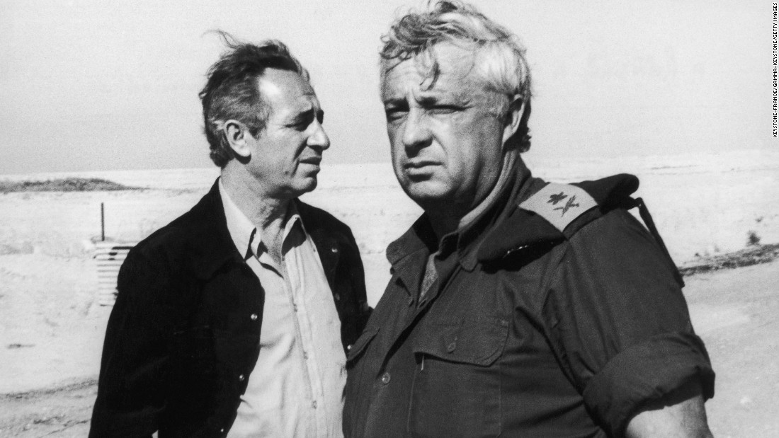 Peres, left, with then-Israel Defense Minister Ariel Sharon on January 2, 1974 in Ras Sudar in Egypt's Sinai Desert. The two were visiting one of the sites of the 1973 Yom Kippur War between Israel and a coalition of Arab states.