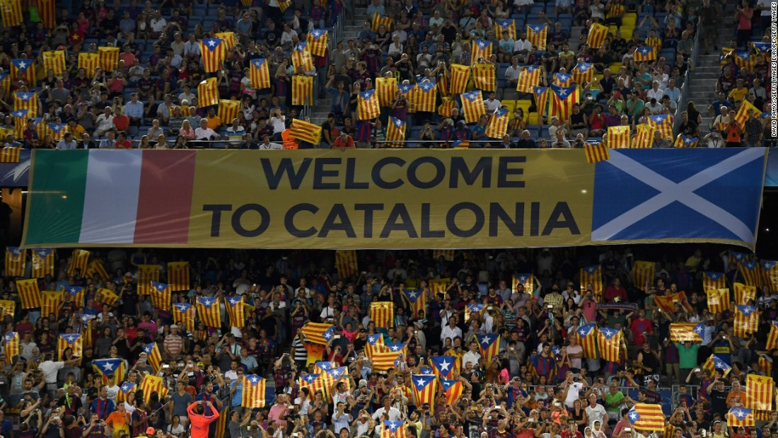 "Barcelona fans hold up Catalan flags during the match against Celtic. The flag, known locally as the ""Estelada,"" has in recent years become a symbol of the independence movement within Catalonia. UEFA outlaws the use of objects that transmit political messages."
